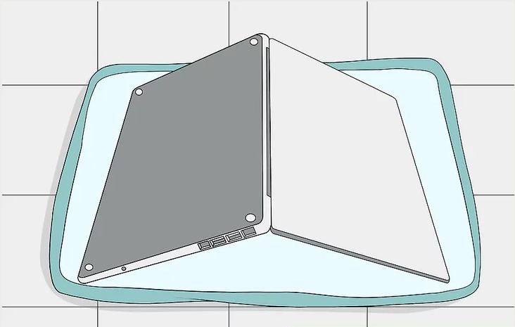 Đặt laptop úp trên bề mặt phẳng lót khăn